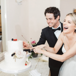 Ali Fedotowsky wearing designer, Val Stefani, at wedding reception with Kevin Manno
