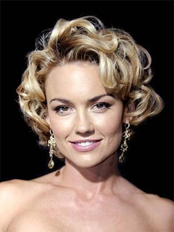 Stack perms give curl and volume to one-length hair cuts by means of ...