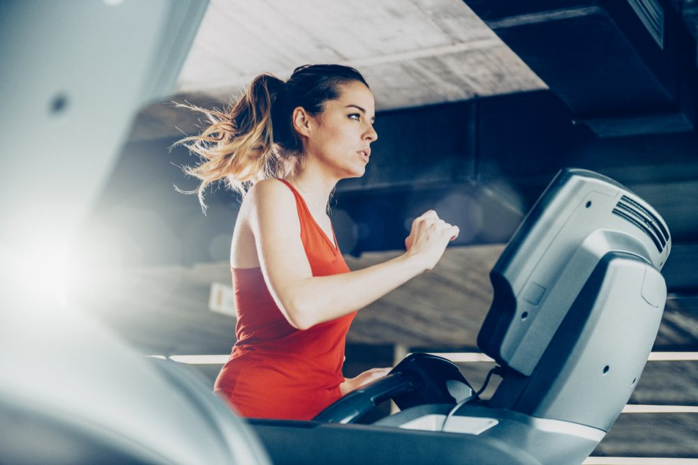 Healthy Woman Running on Treadmill